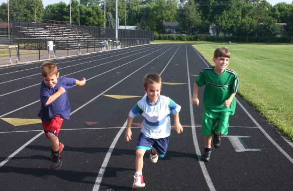 bigstockphoto_kids_running_on_track_7819021